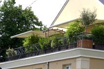 Store banne coffre haut de gamme pour balcon